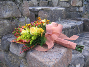 Wedding bouquet sitting on old stone steps